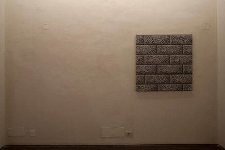 The Wall, print on PVC reproduces the wall of a building below a restoration site, fixed on a canvas 100 x 100 cm, 2012